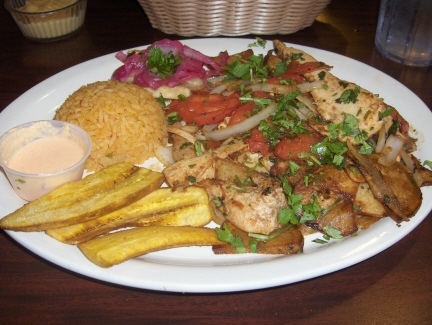 Pollo saltado with yellow sauce
