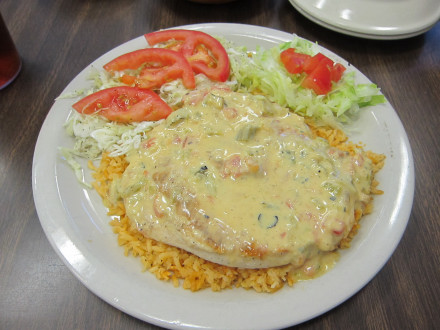 Chicken breast with chile con queso