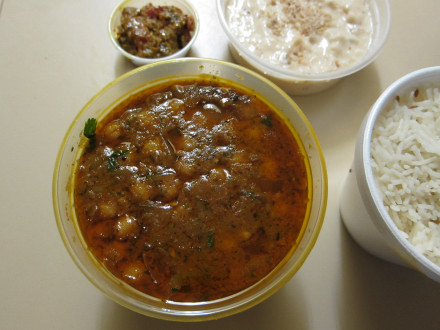 Chana masala in a takeout container