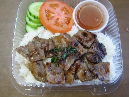 Grilled pork rice platter in a to go order