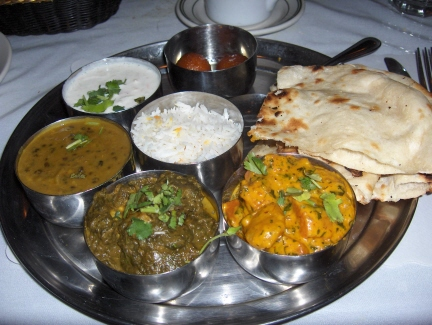 The vegetarian dinner with dal, vegetable korma, and palak paneer with side dishes