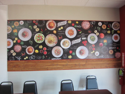 The east wall shows the pasta that is on the menu