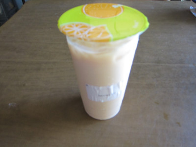 Black milk tea served to go