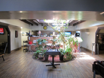 Fountain and indoor patio from the former Griggs Restaurant